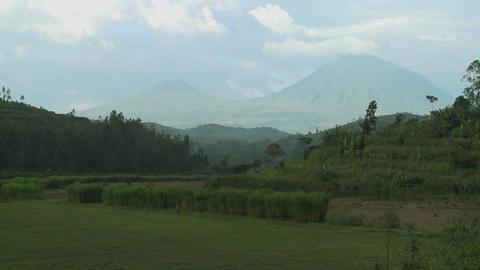 Establishing shot of the Virunga Volcanos on the Rwanda... Stock Video Footage