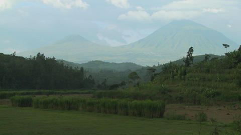 Slow zoom out reveals the Virunga volcano chain on the... Stock Video Footage