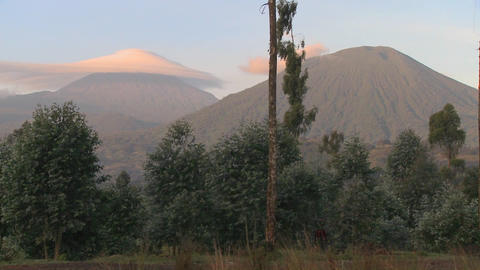 A strange cloud formation forms at the summit of the Virunga volcano chain on the Rwanda Congo borde Footage