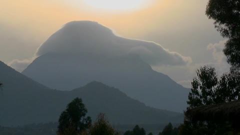 Time Lapse shot of clouds on top of the Virunga volcano chain on the Rwanda Congo border Footage