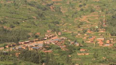 A small village in rural Rwanda, from a distance Stock Video Footage