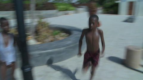 African children run and jump off a dock at Stone Town,... Stock Video Footage
