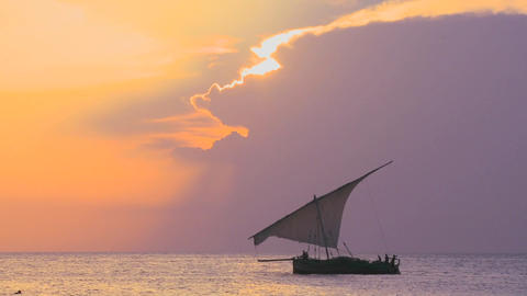 A beautiful sunset shot of dhow sail boat sailing off the... Stock Video Footage