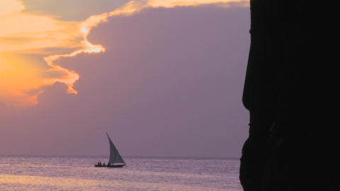 A sailboat silhouetted against a beautiful sunset in Zanzibar Footage