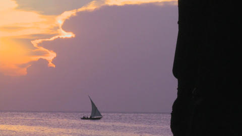 A sailboat silhouetted against a beautiful sunset in... Stock Video Footage