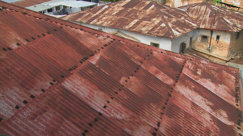 Rusted red rooftops in Stone Town, Zanzibar Stock Video Footage