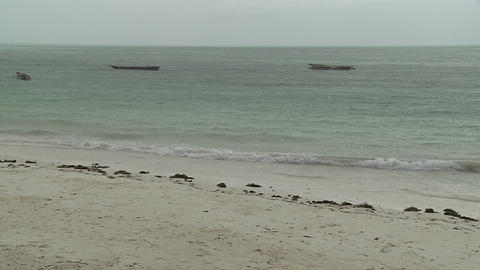 Ocean waves roll into shore Footage