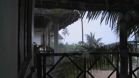 Rain pours down on a tropical beach resort Stock Video Footage