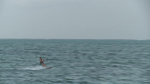 A windsurfer passes by Footage