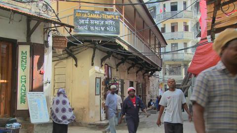 People walk on the streets of Stone Town, Zanzibar Stock Video Footage