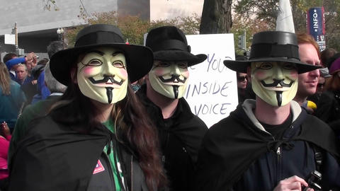 Three masked men posing at the Jon Stewart rally in... Stock Video Footage