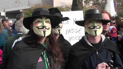 Three masked men posing at the Jon Stewart rally in Washington DC Footage