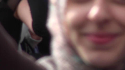 A Muslim woman holds up a sign imploring people not to... Stock Video Footage