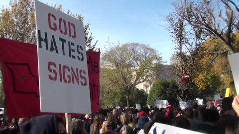 A sign ironically proclaims that God hates signs at the Jon Stewart rally Footage