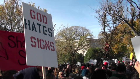 A sign ironically proclaims that God hates signs at the... Stock Video Footage