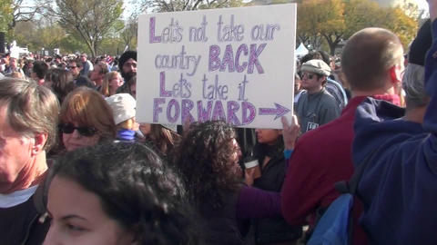 People at a political rally hold up signs urging the... Stock Video Footage