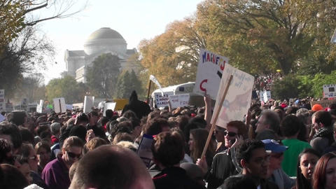 A large political rally with signs on the mall in Washington D.C Footage