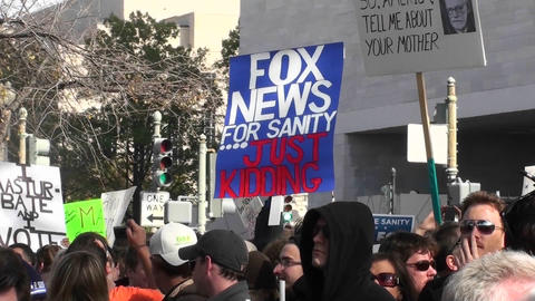 A sign at a rally says Fox News For Sanity Just Kidding Footage