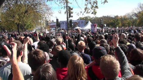Crowds of protestors on the mall in Washington D.C. does the wave Footage