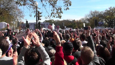 Thousands of protestors applaud en masse on the... Stock Video Footage