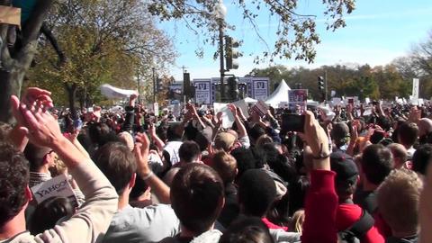 Thousands of protestors applaud en masse on the... Stock Video Footage
