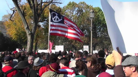 A peace flag flies at a political rally in Washington D.C Footage