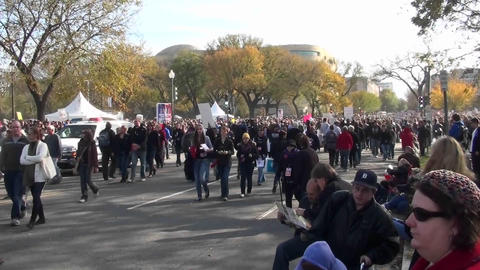 Huge crowds walk in a demonstration in Washington D.C Stock Video Footage