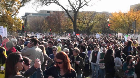 Huge crowds mill about at a political protest in... Stock Video Footage