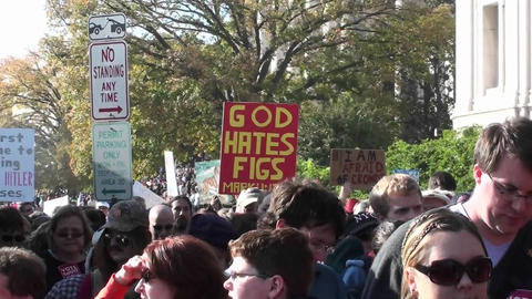 A sign is carried at a rally stating that God hates figs Stock Video Footage