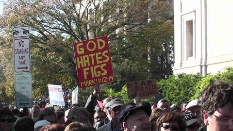 A sign is carried at a rally stating that God hates figs Footage