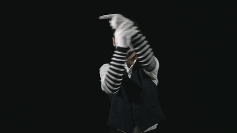 Young funny mime pointing and performing a comedy pantomime act Footage