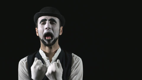 Young hilarious mime making funny faces Footage