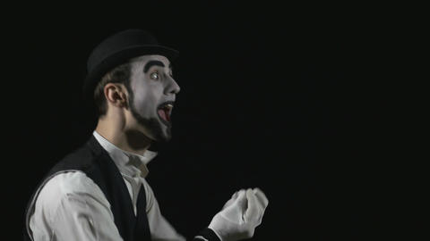 Young funny shouting mime using a megaphone Footage