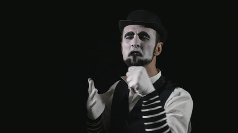 Young funny singing mime singing and being deafened by a megaphone Footage