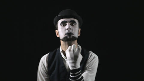 Young hilarious scary crazy evil mime making funny faces Footage