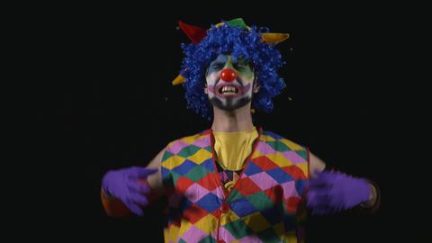 Young hilarious clown bursting into an evil laugh Footage