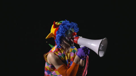 Young funny clown shouting and using a megaphone Footage