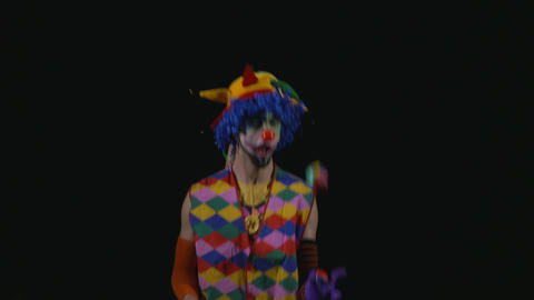 Young funny hilarious clown juggling Footage
