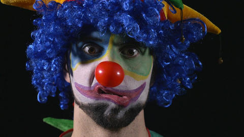 Close-up of young hilarious clown making funny faces Footage