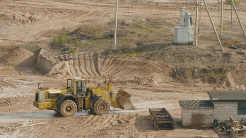 Trucks machine works in the sand ballast quarry on the cloudy summer day Live Action