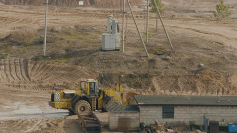 Trucks machine works in the sand ballast quarry on the… Stock Video Footage