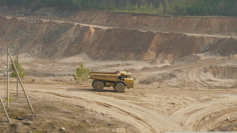 Big dump truck carries the sand in the ballast quarry Live Action