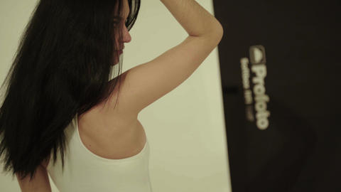 Backstage photography. Photoshoot. Model posing to the photographer Live Action