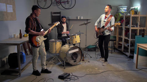 Young musicians in garage have a repetitioon Live Action