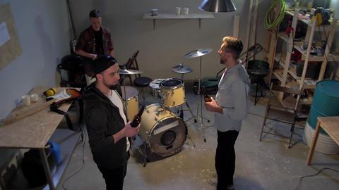 Musicians drink beer in the garage Live Action