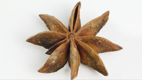 Star anise, spice rotates on the table on white background Live Action