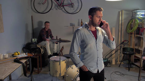 The musician speaks on smartphone Live Action