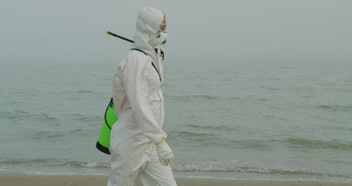Researcher in protective coveralls and mask walking in radioactive area ライブ動画