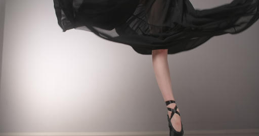 Legs of the dancing balerine standing on the ends of her pointe shoes, woman Live Action