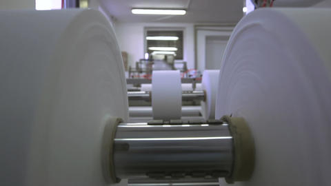 Roll of fabric in a production machine, close up Live Action